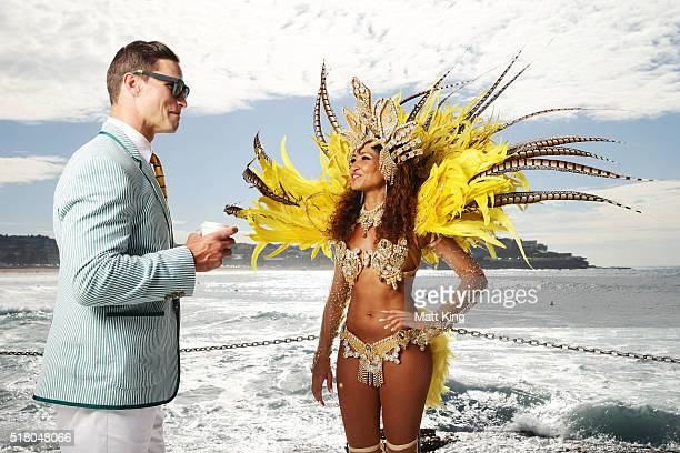 Australian athlete Ed Jenkins talks to a Brazilian dancer during the Australian Olympic Games Opening Ceremony Uniform Official Launch at Bondi...