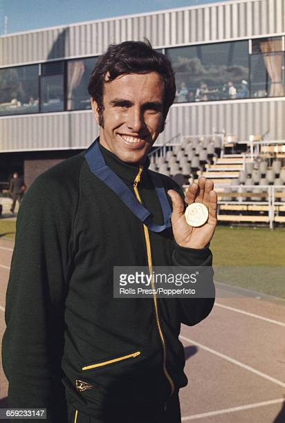 Australian athlete Geoff Smith holds his gold medal after finishing in first place in the Decathlon event at the 1970 Commonwealth Games in...