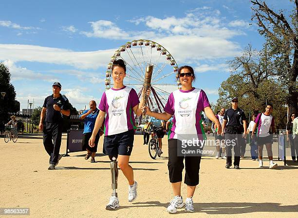 Australian athlete Kelly Cartwright and Manpreet Singh carry the baton as part of the Delhi 2010 Commonwealth Games Queen's Baton relay at Birrarung...