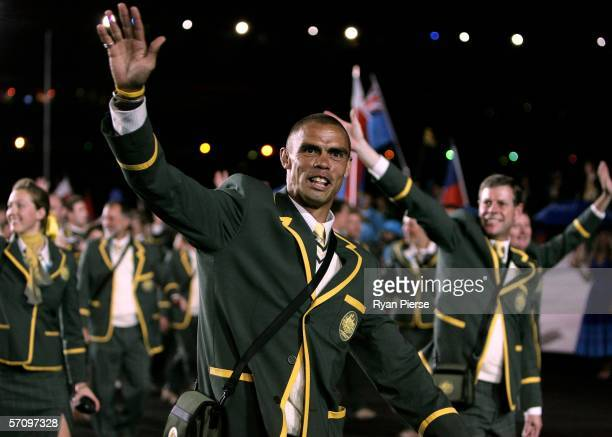 Australian athlete Kyle Vander Kuyp waves to the crowd during the Opening Ceremony for the Melbourne 2006 Commonwealth Games at the Melbourne Cricket...