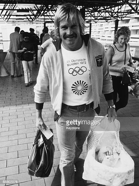 Australian athlete Leslie Humm at the Munich Olympic village with his baby daughter Melanie 31st August 1972