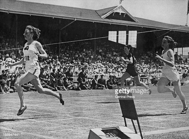 Australian athlete Marjorie Jackson wins the first heat of the Women's 220 Yards at the British Empire Games in Auckland, New Zealand, setting a new...