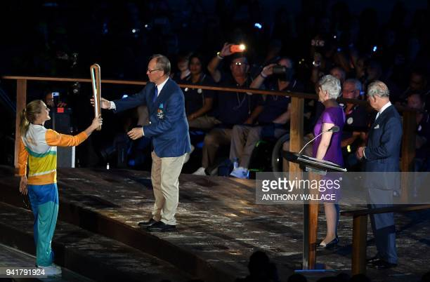 Australian athlete Sally Pearson hands the Queen's Baton to 2018 Gold Coast Commonwealth Games Organising Committee Chairman Peter Beattie as...