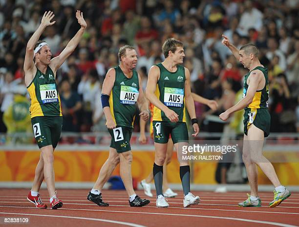 Australian athletes Christopher Mullins Darren Thrupp Evan O'Hanlon and Timothy Sullivan celebrate their victory in the men's 4x100m relay T35T38...