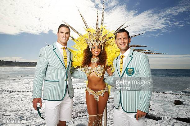 Australian athletes Ed Jenkins and Jamie Dwyer pose with a Brazilian dancer during the Australian Olympic Games Opening Ceremony Uniform Official...