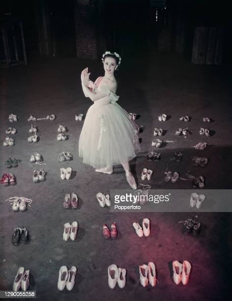 Australian ballerina Elaine Fifield posed among pairs of ballet shoes at the Sadler's Wells Theatre Ballet company in London in October 1948.