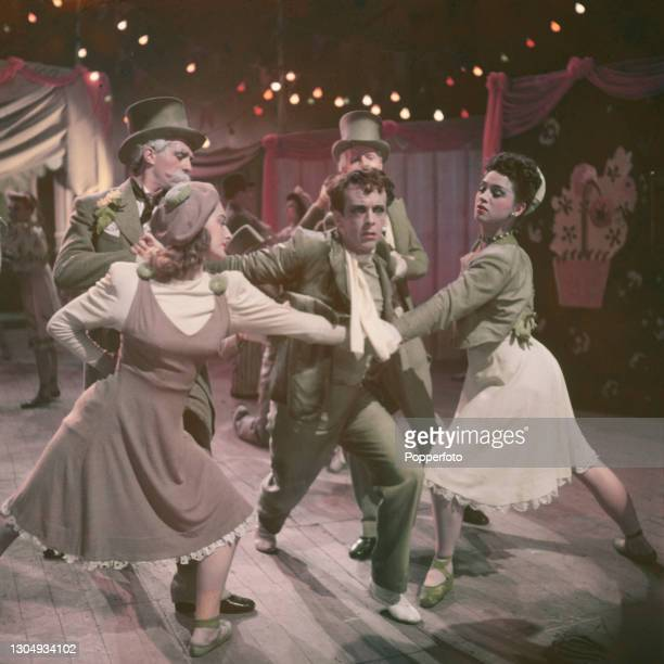 Australian ballet dancer Robert Helpmann appears with dancers in a scene, playing the role of Ivan Boleslawsky, during filming of the British drama...