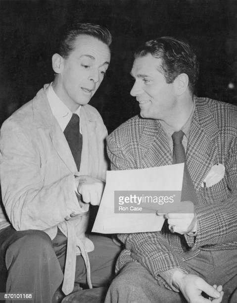 Australian ballet dancer Robert Helpmann goes over the script for the festival play 'Caesar and Cleopatra' with actor Sir Laurence Olivier during...