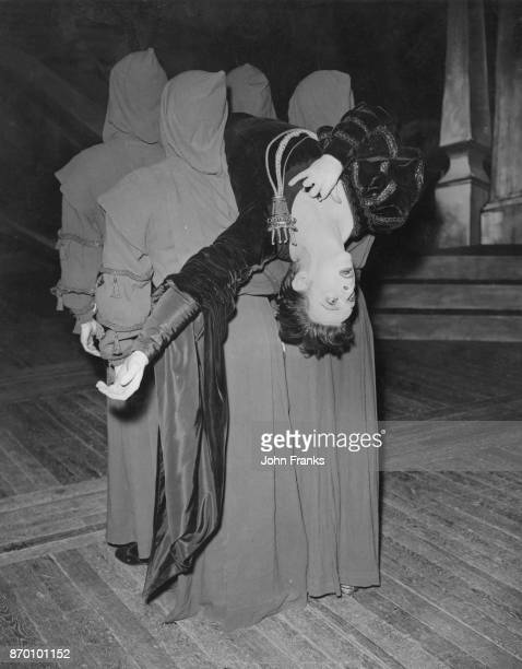 Australian ballet dancer Robert Helpmann performs the death of Hamlet during rehearsals for a revival of his ballet 'Hamlet' at the Royal Opera House...