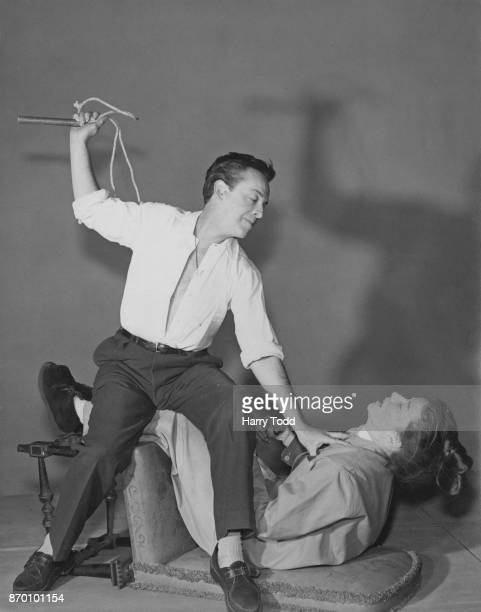 Australian ballet dancer Robert Helpmann rehearses with costar Katharine Hepburn for an Old Vic production of the Shakespeare play 'The Taming of the...