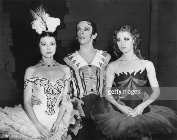 Australian ballet dancer Robert Helpmann with costars Margot Fonteyn and Moira Shearer during a dress rehearsal for the Frederick Ashton ballet 'Don...