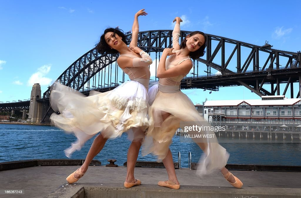 Australian ballet dancers Vivienne Wong (L) and Dimity Azoury (R) perform at the unveiling of the Toni Maticevski designed costumes for the Australian Ballet production of Tinted Windows, part of the Bodytorque.Technique season opening this week in Sydney on October 30, 2013. The Australian Ballet has six brand-new works from up-and-coming Australian choreographers making their debut, creating a fantastic fusion of experimental ballet, design, fashion and music. AFP PHOTO/William WEST