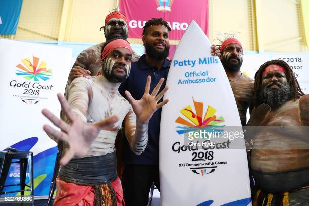 Australian basketball champion Patty Mills poses with indigenous dancers at Keebra Park High School on July 26 2017 in Gold Coast Australia Mills has...