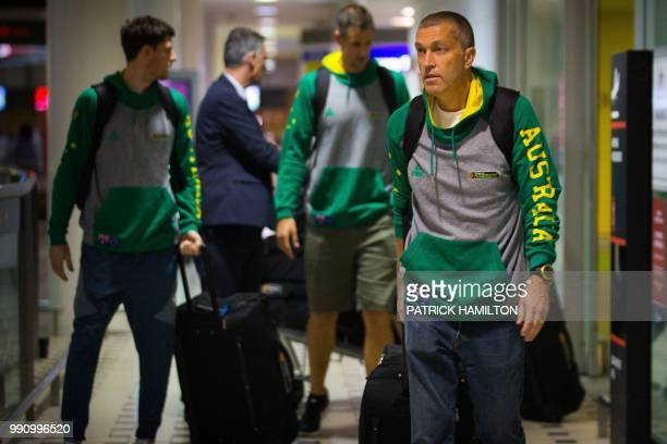 Australian basketball head coach Andrej Lemanis arrives with fellow team members at Brisbane airport on July 4 two days after their FIBA World Cup...