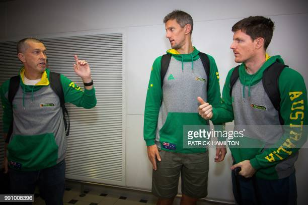 Australian basketball head coach Andrej Lemanis Daniel Kickert and Cameron Gliddon chat during a press conference at Brisbane airport on July 4 two...