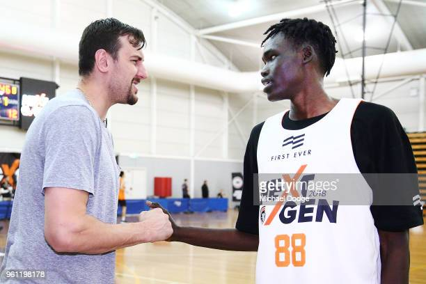 Australian Basketballer Andrew Bogut who will play for the Sydney Kings next NBL season meets Sydney Kings development squad player Deng Acouth at...