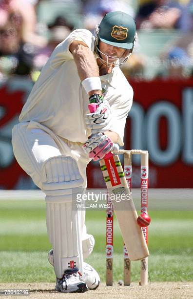 Australian bastman Matthew Hayden snicks a ball to the boundary from the Indian bowling during the first day of the first Test match at the MCG in...