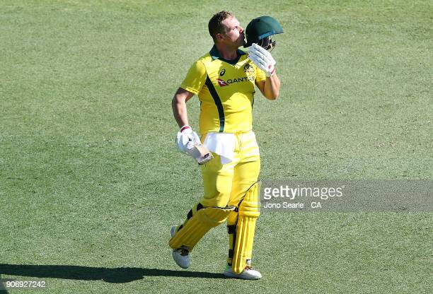 Australian batsman Aaron Finch celebrates scoring 100 during game two of the One Day International series between Australia and England at The Gabba...