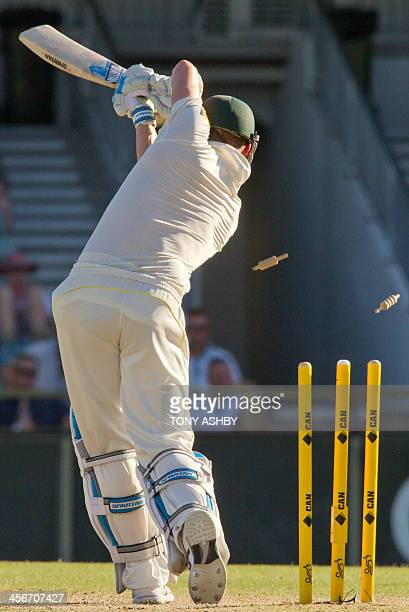 Australian batsman and captain Michael Clarke is bowled by England's Ben Stokes on the third day of the third Ashes cricket Test match in Perth on...