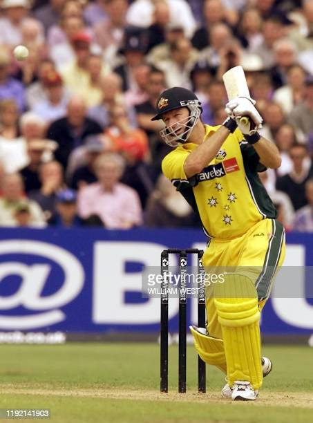 Australian batsman and captain Steve Waugh drives a ball through the covers from England's bowler Dominic Cork in their match being played at Old...