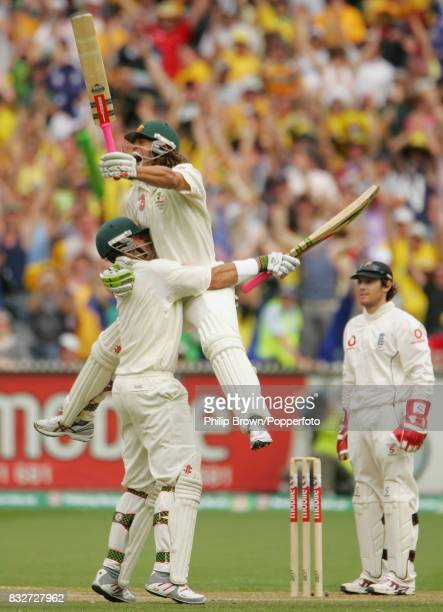 Australian batsman Andrew Symonds celebrates reaching his century during his innings of 156 with batting partner Matthew Hayden during the 4th Test...
