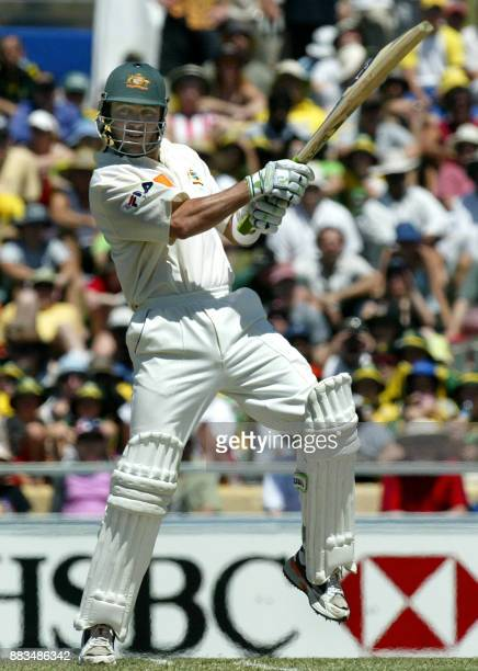 Australian batsman Damien Martyn cuts the ball for four runs, during the second day's play in the third Ashes test against England at the WACA ground...