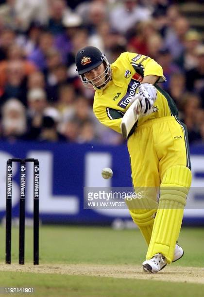 Australian batsman Damien Martyn drives a ball from an English bowler in their match being played at Old Trafford in Manchester 14 June 2001....