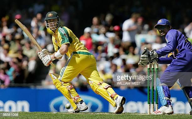 Australian batsman Damien Martyn hits a ball to square as Sri Lankan wicketkeeper Kumar Sangakkara looks during their one-day match in Melbourne 13...