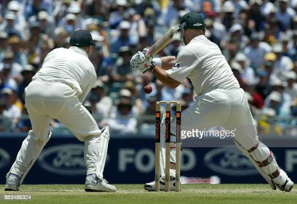 Australian batsman Darren Lehmann , prepares to cut the ball in front of wicket-keeper Alec Stewart , during the second day's play in the third Ashes...