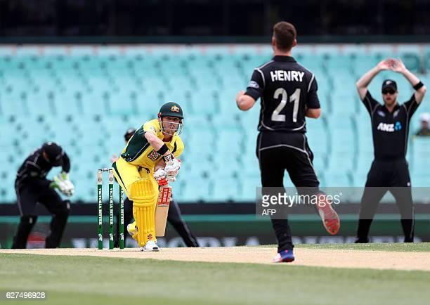Australian batsman Dave Warner bats to New Zealand paceman Matt Henry on the first day's ODI cricket match between Australia and New Zealand in...