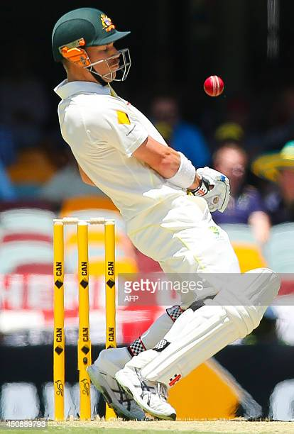 Australian batsman David Warner avoids a rising delivery from England bowler Chris Tremlett during day one of the first Ashes cricket Test match...