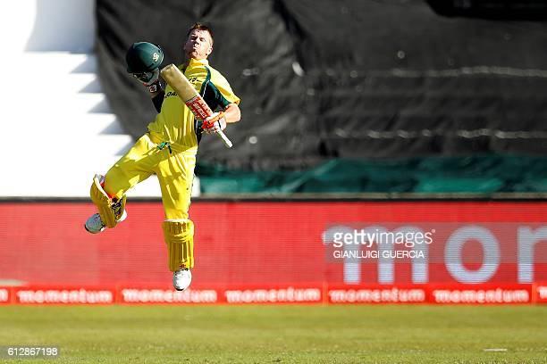 Australian batsman David Warner celebrates scoring a century during the third ODI between South Africa and Australia at Kingsmead cricket stadium on...