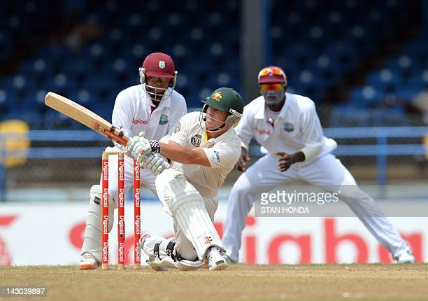 Australian batsman David Warner gets a four during the fourth day of the secondofthree Test matches between Australia and West Indies April 18 2012...
