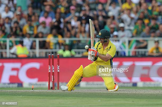 Australian batsman David Warner is bowled by South African bowler Kagiso Rabada during the T20 cricket match between South Africa and Australia at...