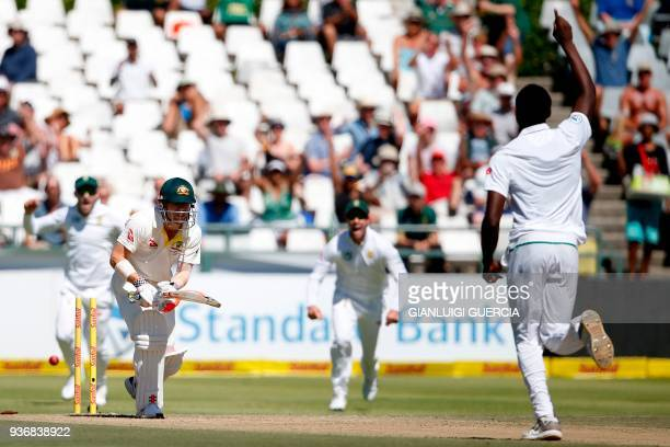 Australian batsman David Warner is bowled out by South African batsman Kagiso Rabada during the second day of the third Test cricket match between...
