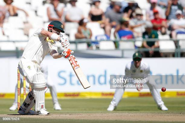Australian batsman David Warner plays a shot during the second day of the third Test cricket match between South Africa and Australia at Newlands...