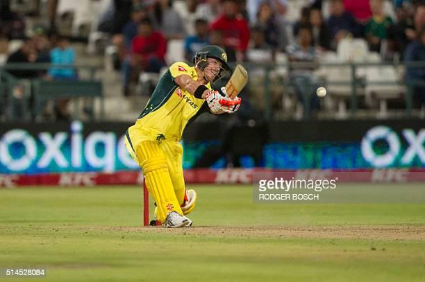 Australian batsman David Warner plays a shot during the third and final T20 cricket match between South Africa and Australia at the Newlands Stadium...