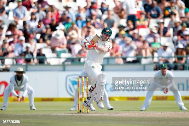 Australian batsman David Warner plays shot during the fourth day of the third Test cricket match between South Africa and Australia at Newlands...