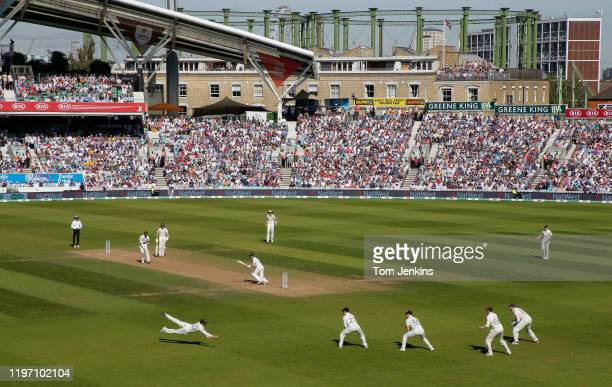 Australian batsman David Warner slashes a shot just past the diving Rory Burns off the bowling of Jofra Archer during day four of the England v...
