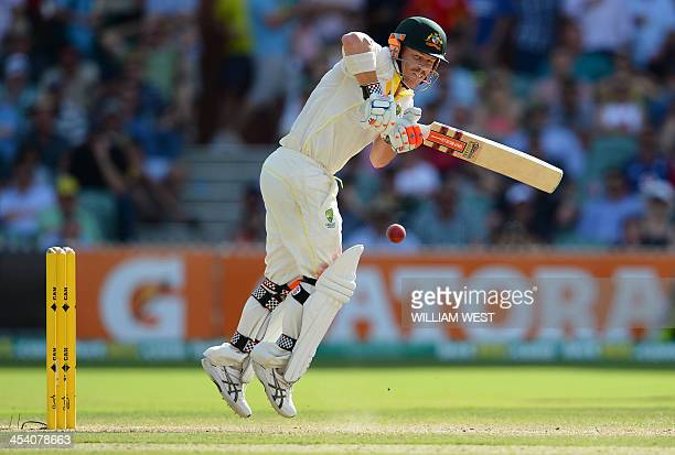 Australian batsman David Warner steers a ball to leg from the England bowling on the third day of the second Ashes cricket Test match in Adelaide on...