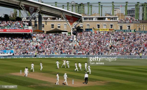 Australian batsman David Warner walks off after his dismissal to Stuart Broad during day four of the England v Australia 5th Ashes test match at The...