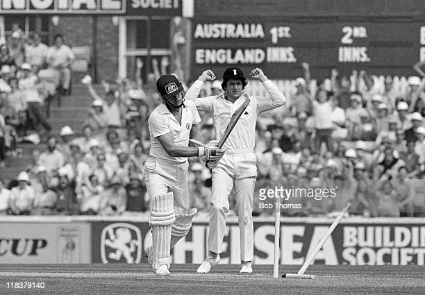 Australian batsman Dirk Wellham is out for 24 runs in the first innings bowled by Bob Willis as Paul Parker celebrates during the 6th Test match...