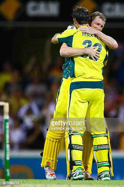 Australian batsman George Bailey embraces Glenn Maxwell on scoring the winning runs during the oneday international cricket match between India and...