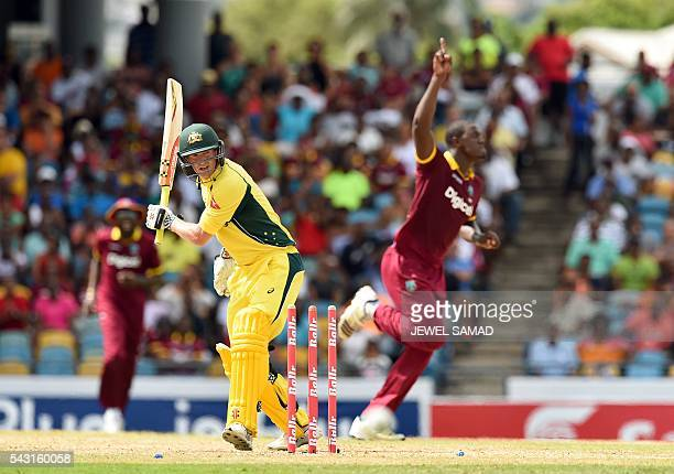 Australian batsman George Bailey reacts after being bowled off West Indies bowler Carlos Brathwaite during the final match of the Trination Series...