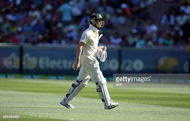 Australian batsman George Bailey walks off ground after being given out caught behind off the bowling James Anderson on the second day of the fourth...