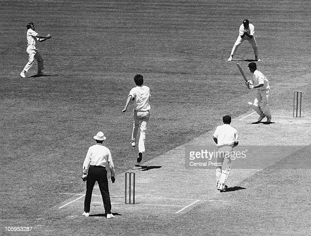 Australian batsman Greg Chapell goes for a square drive off a ball from Bob Willis of England only to be caught out by John Edrich during the Fifth...