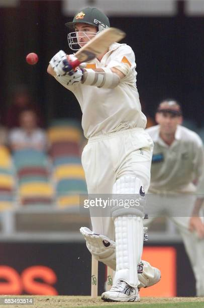 Australian batsman Jason Gillespie lashes out against the New Zealand bowling on the third day of the first Test Match being played at the Gabba in...