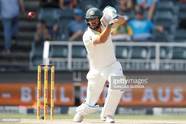 Australian batsman Joe Burns plays a shot during the second day of the fourth Test cricket match between South Africa and Australia at Wanderers...