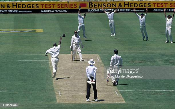 Australian batsman Mark Taylor is out caught by wicketkeeper Steve Rhodes of the bowling of Chris Lewis for 9 runs during the 5th Test match against...