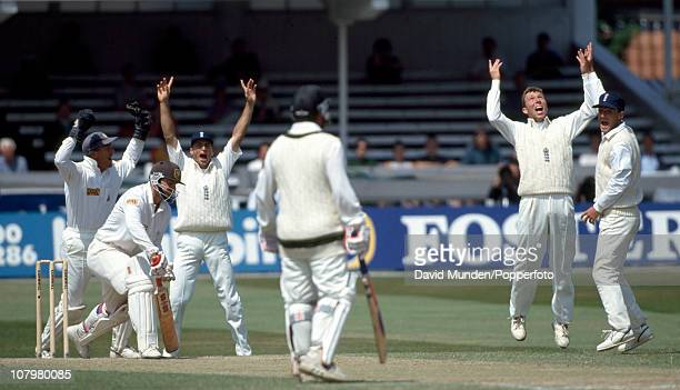 Australian batsman Mark Taylor is out for 28 caught by Michael Atherton off Peter Such during the second innings of the 3rd Test match between...